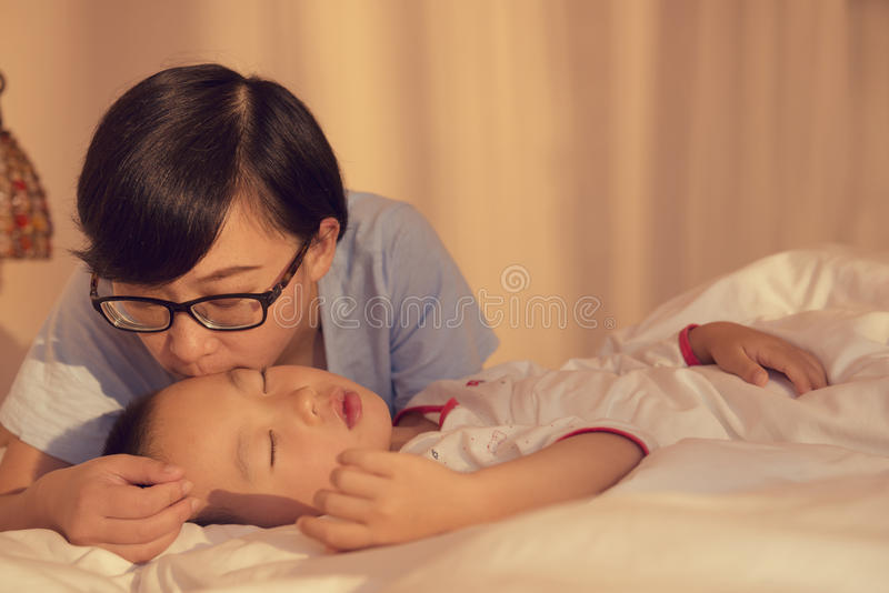 Mother kissing son royalty free stock photos