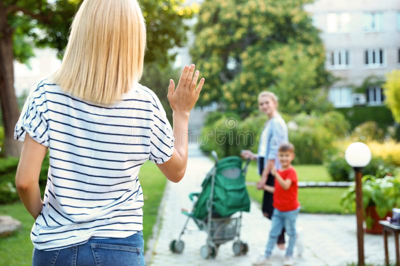 Mother leaving children with teen nanny. Space for text royalty free stock photos