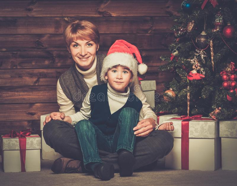 Mother and lIttle boy with gift box stock photography