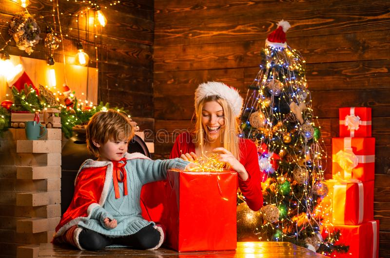 Mother and little child boy son friendly family having fun. Cozy evening at home. Family having fun at home christmas royalty free stock photo
