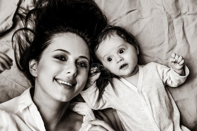 Mother and a little child lying down royalty free stock photos