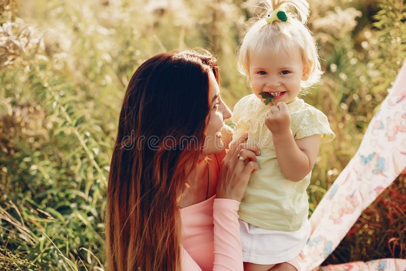 Mother with little daughter stock photos