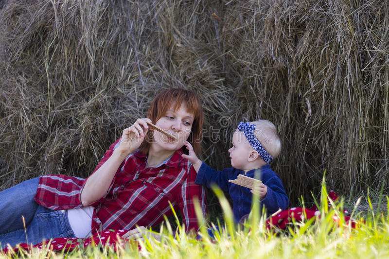 Mother and Little Daughter Eating Crisp Bread Outdoor royalty free stock images