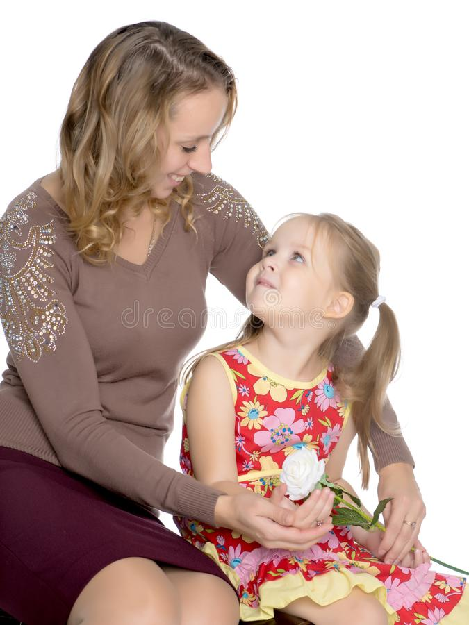 Mother and little daughter gently embrace royalty free stock photography