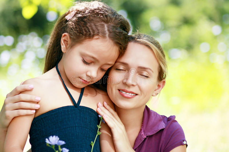 Mother and little daughter on nature stock photography