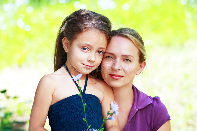 Mother and little daughter on nature royalty free stock photos