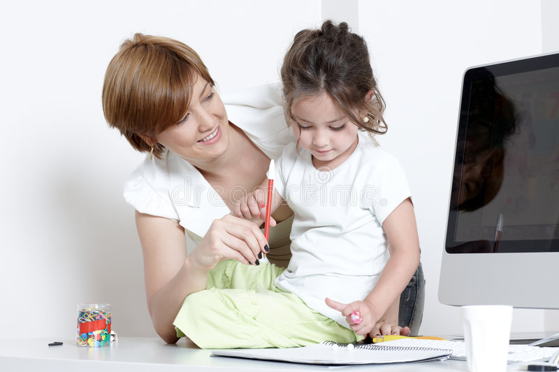 Download Mother With A Little Daughter At Office Stock Image - Image of writing, adult: 8622579