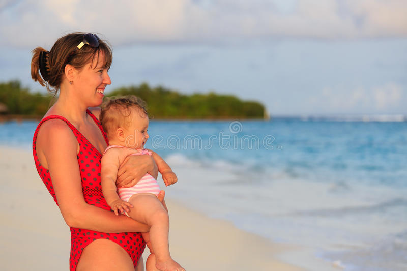 Mother and little daughter on sea vacation. Mother and daughter enjoying tropical sea vacation royalty free stock photos