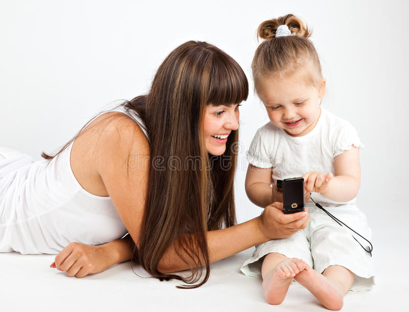 Download Mother  And Little Daughter Speaking By Phone Stock Image - Image: 10107931