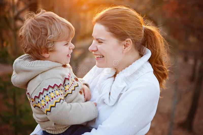 Mother and little son in park or forest, outdoors. stock images