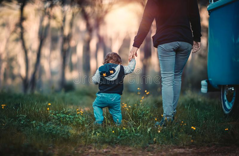 Mother and son camping. Mother with little son walking in the forest, weekend camping in the countryside, family enjoying spending time together, love and family royalty free stock photo