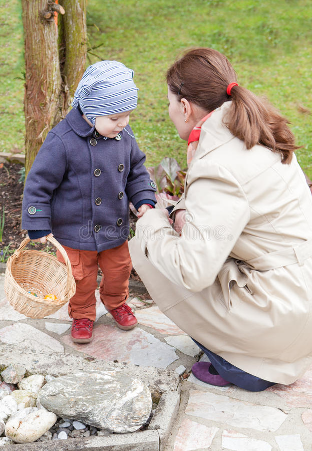 Mother and little toddler boy on Easter Egg Hunt stock images