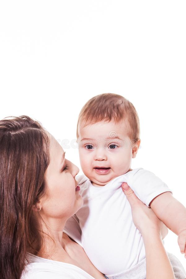 Mother looking at her amazed baby. Attractive young mother looking at her wondering blue-eyed baby royalty free stock photo