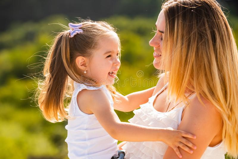 Mother love. Happy woman and little girl daughter smiling. Happy family mother and child daughter hugging and kissing royalty free stock image