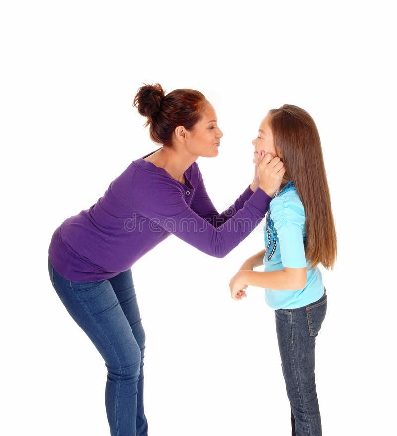 Mother loving her girl. stock photo