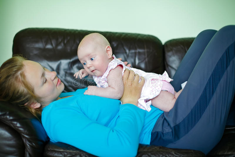 Download Mother Lying With Baby stock photo. Image of child, parent - 19718768