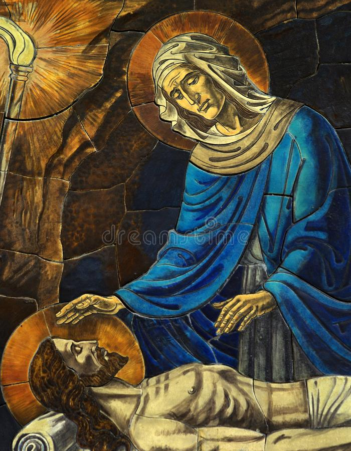 Mother Mary grieving over het dead son Jesus mosaic. A beautiful photo of Mother Mary grieving over het dead son Jesus mosaic stock photography