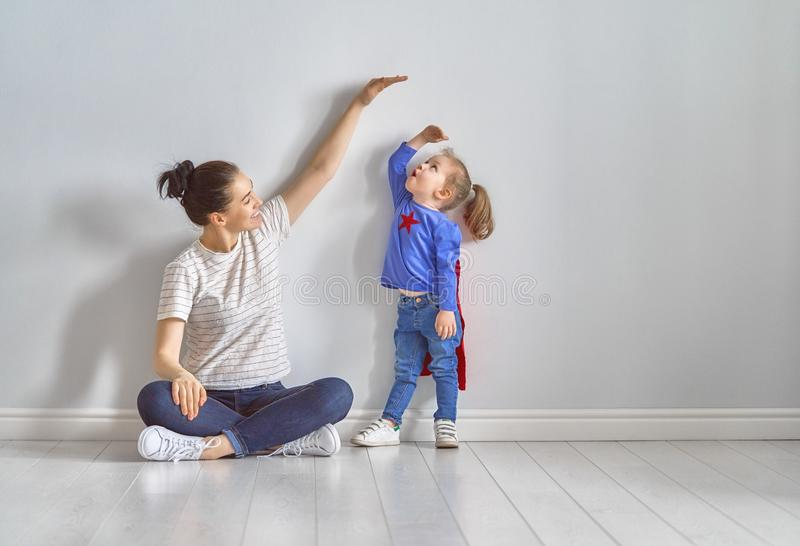 Mother is measuring growth of child stock images