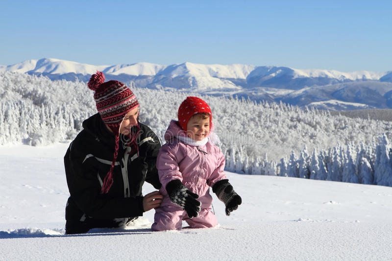 Mother mom and baby in winter snow royalty free stock photo