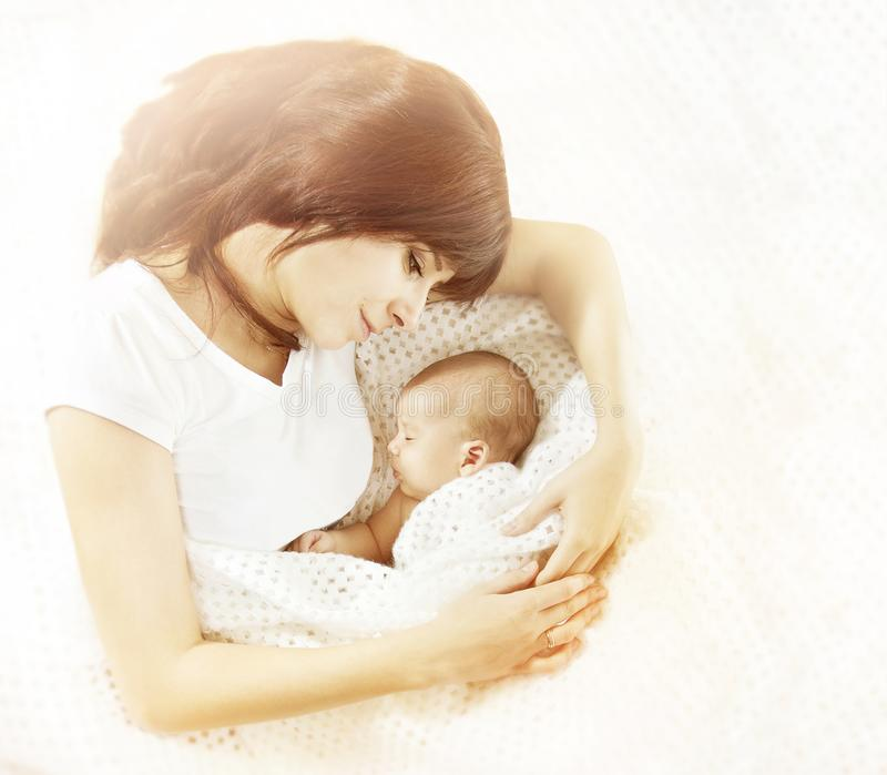 Mother and Newborn Baby Family, Mom Looking to New Born Child. Woman and her Kid royalty free stock image