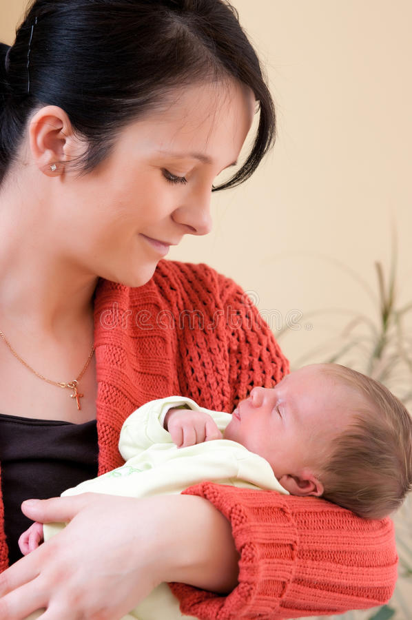 Mother and newborn baby girl stock photos