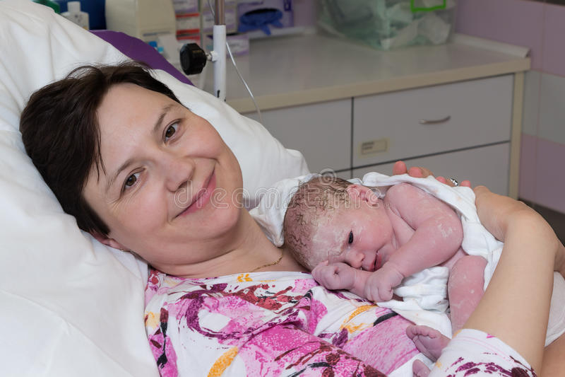 Mother with newborn baby royalty free stock photos