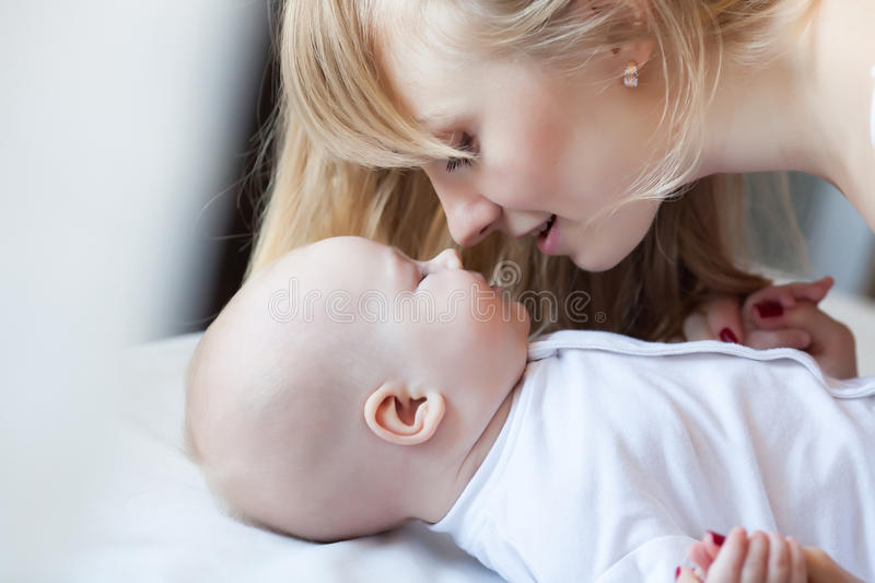 Mother with newborn girl stock photography