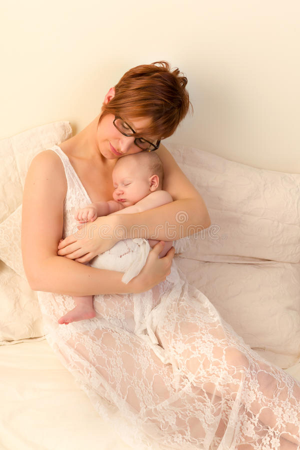 Mother and newborn son stock photo