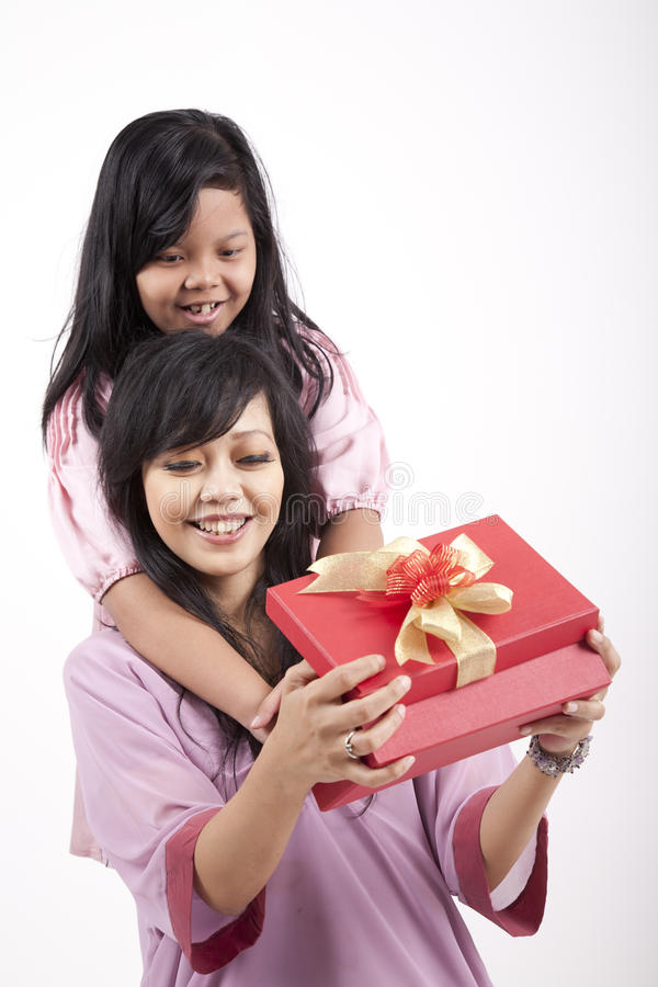 Download Mother Opening A Gift From Her Daughter Stock Photo - Image: 21713914