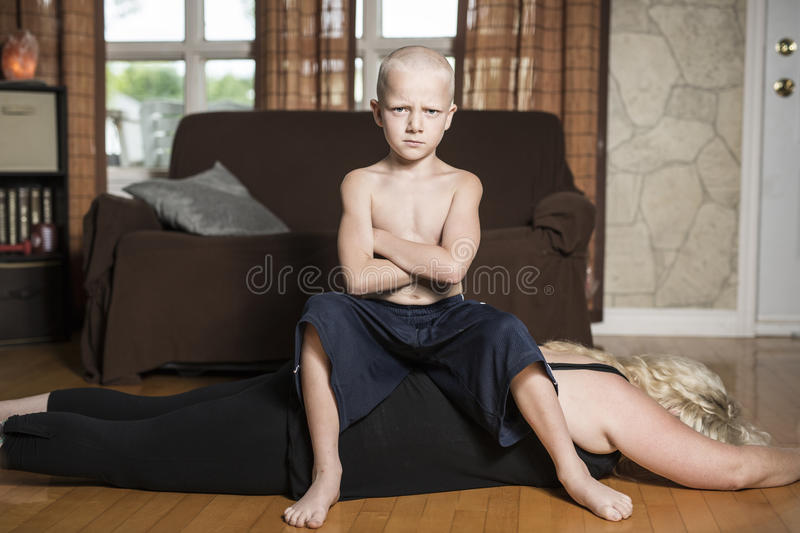Mother Parent down before their son are king royalty free stock image