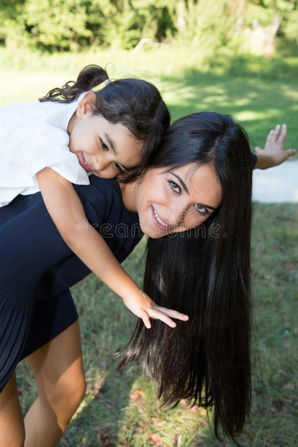 Mother parent give piggyback ride to child royalty free stock photo