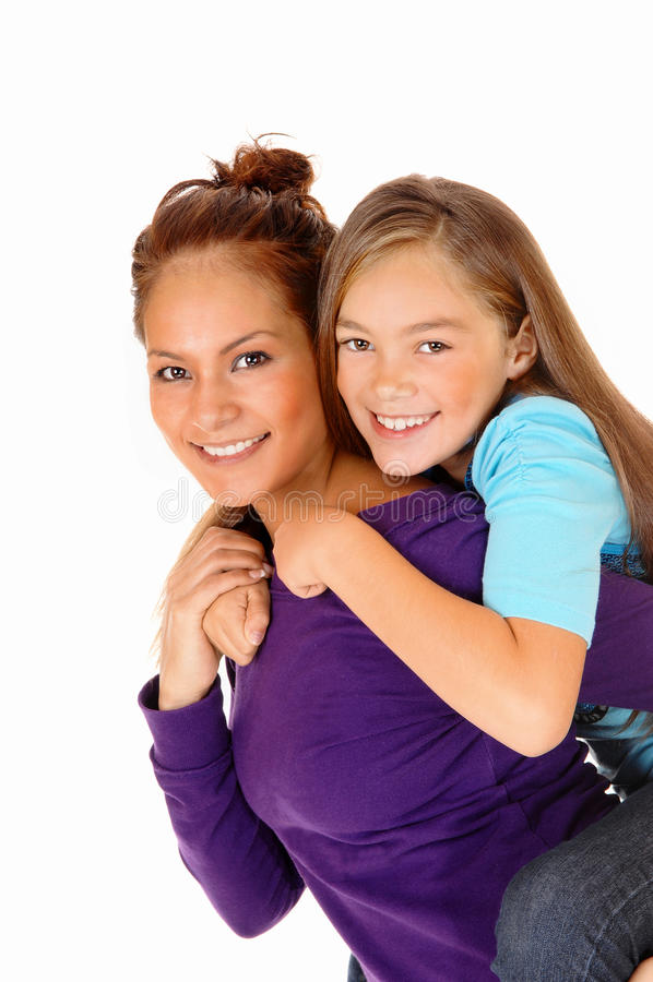 Mother piggyback her daughter. royalty free stock photography