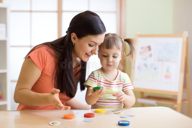 Mother play with child daughter stock photos