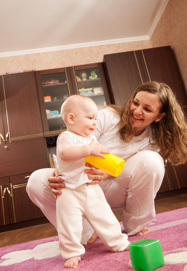 Download Mother playing with baby stock image. Image of looking - 21492297
