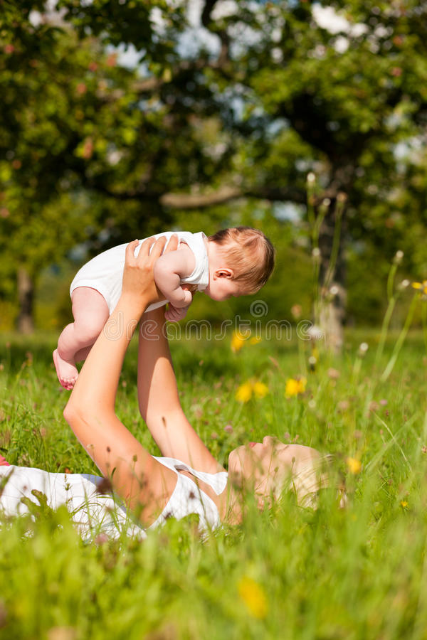 Download Mother Playing With Baby On Meadow Stock Image - Image of sunny, happiness: 15996245