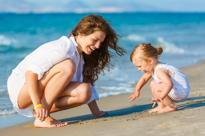 Download Mother Playing With Daughter On The Beach Stock Photo - Image: 27920162