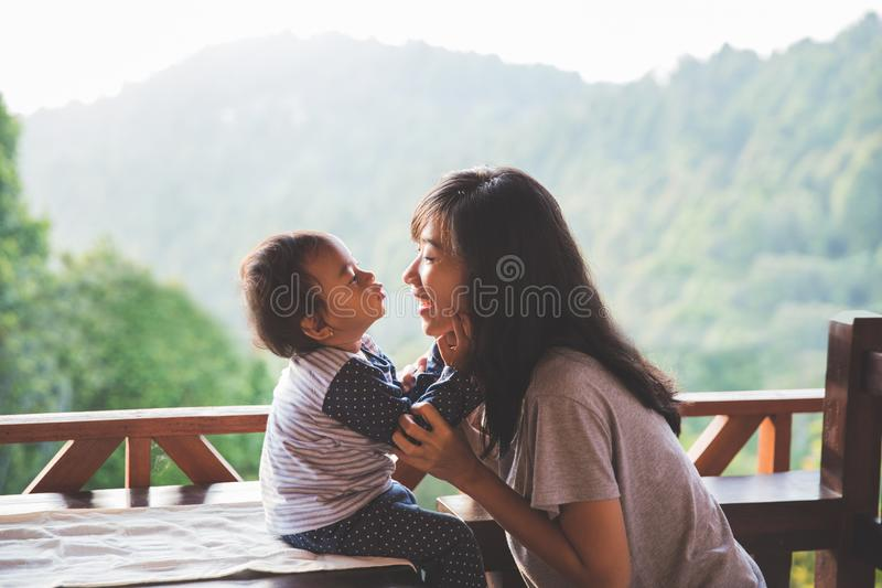 Mother playing with daughter. Beautiful view of young mother playing with daughter at the mountain background. Family vacation. Travel royalty free stock images
