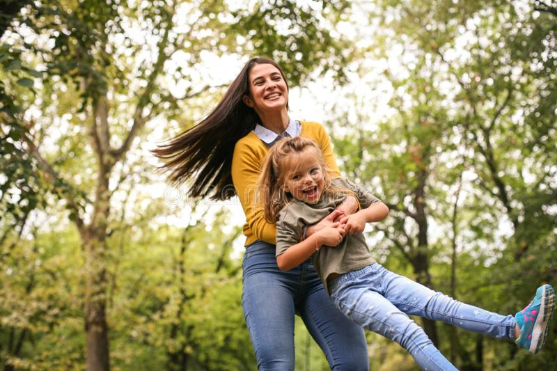 Mother playing with daughter. On the move. Lifestyle stock images