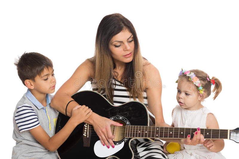 mother playing guitar for their children stock photo image 45227336. Black Bedroom Furniture Sets. Home Design Ideas