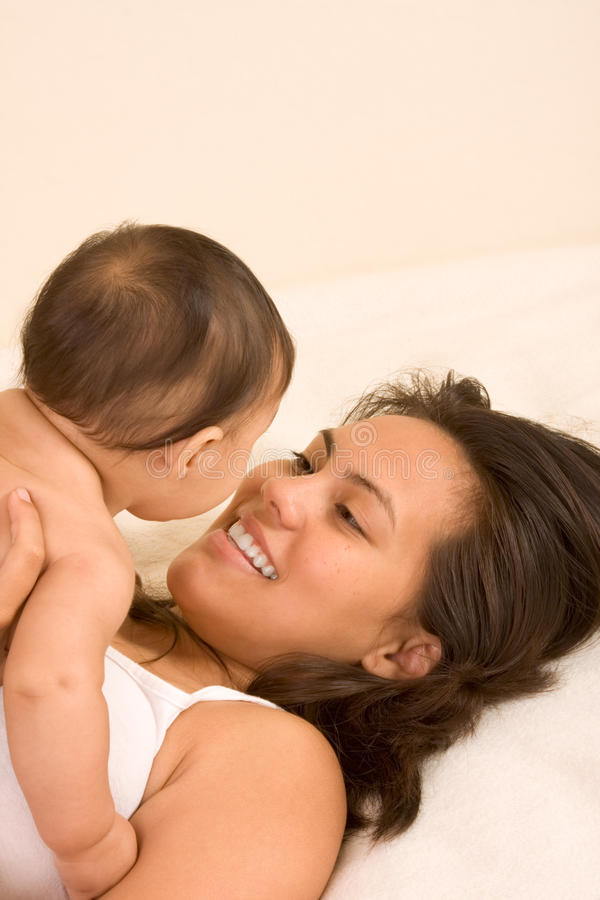 Mother playing with her baby boy son stock photos