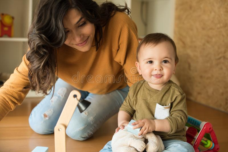 Mother playing with her baby stock image