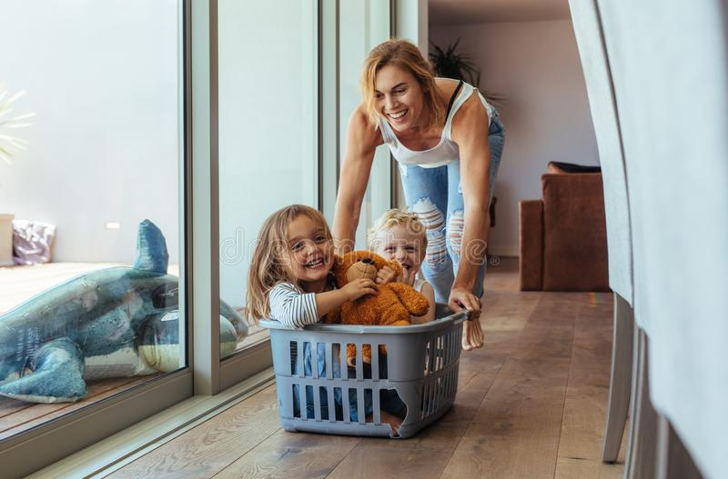 Mother playing with her children at home stock photos