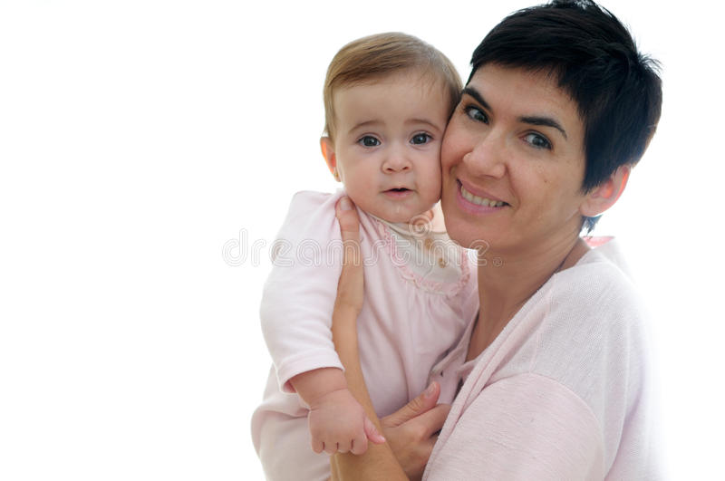 Mother playing with her little daughter stock photos