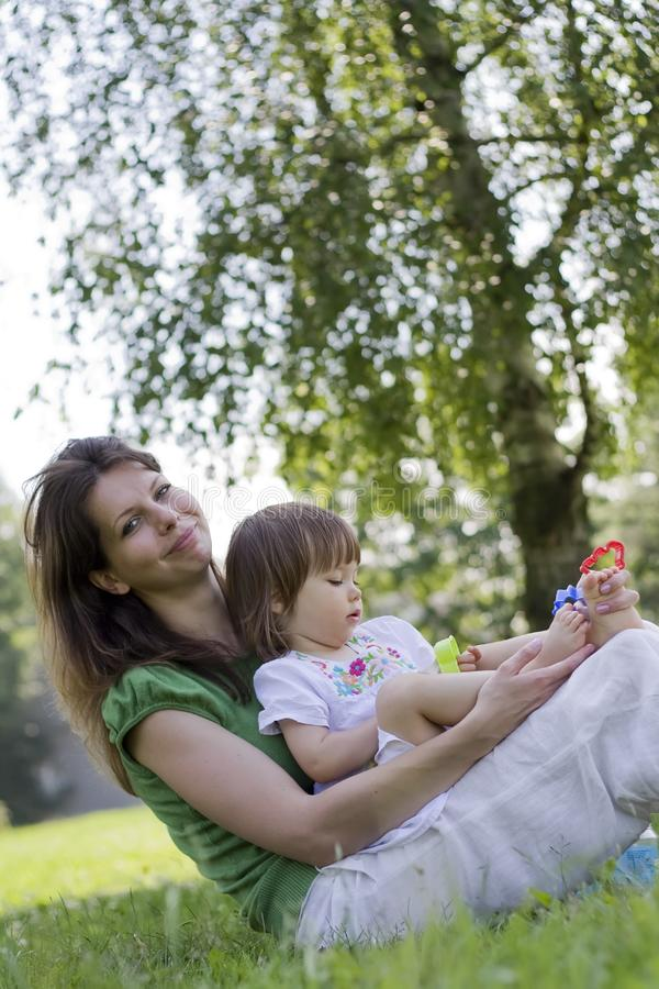 Download Mother Playing With Her Little Daughter In Park Stock Image - Image of park, caucasian: 15089899