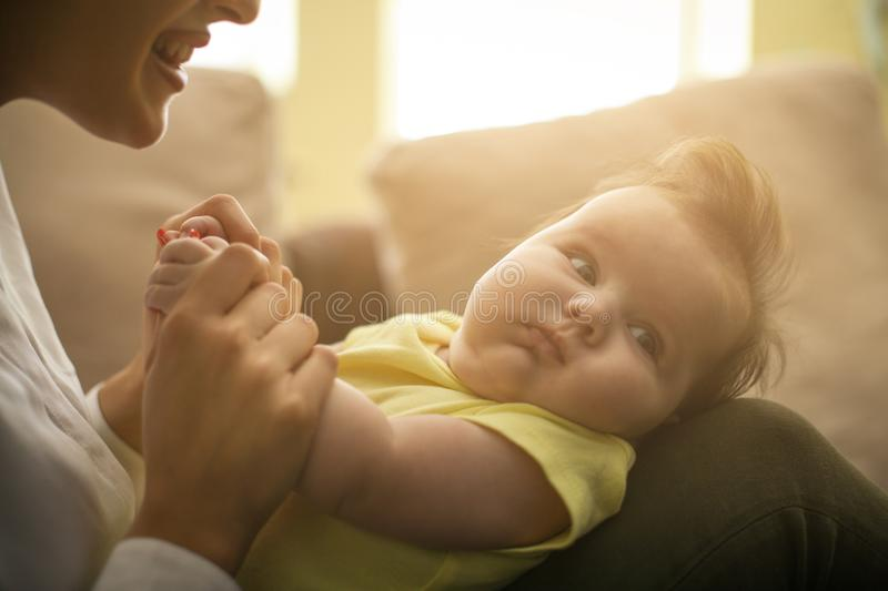 Mother playing with her little girl at home. Close up. stock photos