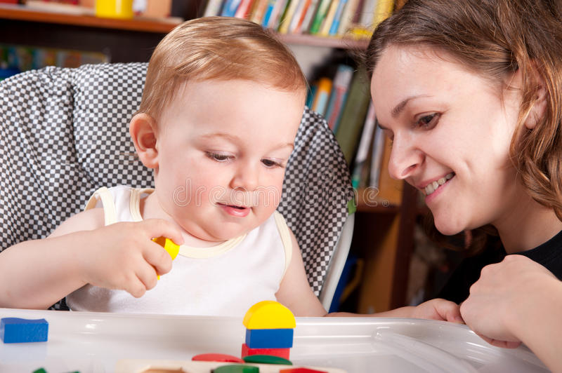 Mother Playing With Her Son In Blocks Stock Photo