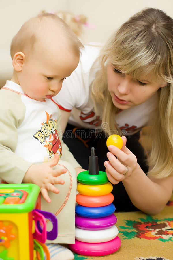 Download Mother plays with son stock image. Image of constructor - 9200167
