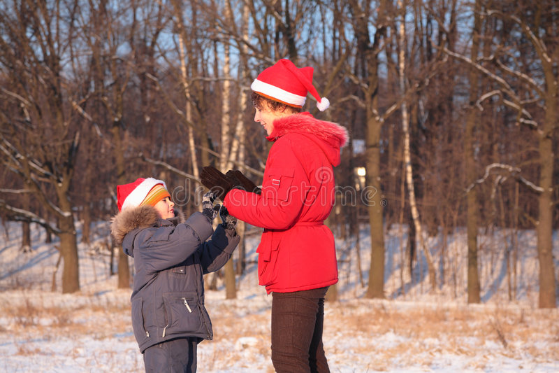 Mother plays with son in winter stock image