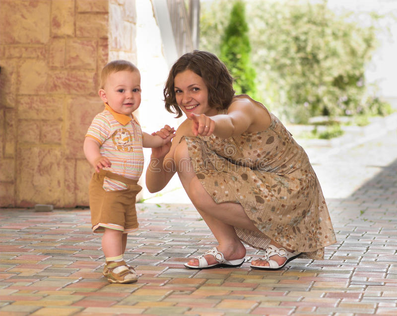 Download Mother Is Pointing On Camera Stock Photo - Image: 10069100
