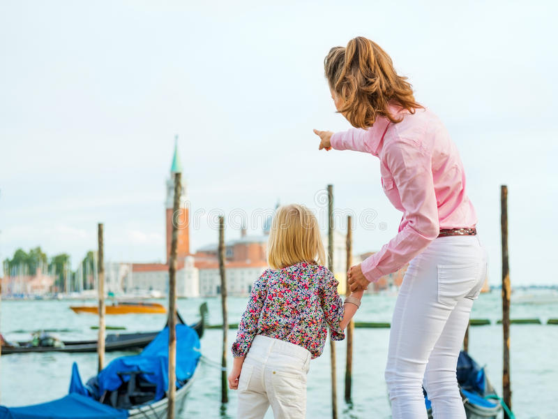 Mother pointing out San Giorgio Maggiore church to daughter stock images